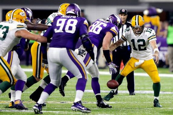 Aaron Rodgers fumbled the ball three times and was sacked five times in the Packers' loss to the Vikings. Jamie Squire/Getty Images