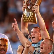 Paul Gallen lifts the trophy high