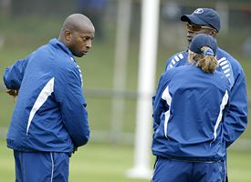 Yale women's soccer coach Rudy Meredith confers with his assistants during a game last season.