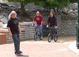 Dinosaur Jr.: J. Mascis on board and Murph and Lou Barlow on bikes.