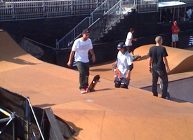 Koston took a break from the street course to roll the park set up for a bit.
