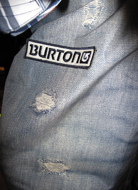 Distressed jeans with Burton patch begs the question: How will the world receive the casual appearance of an Olympic uniform?