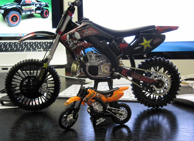 Brian Deegan's Mega Scale bike next to the standard sized toy.