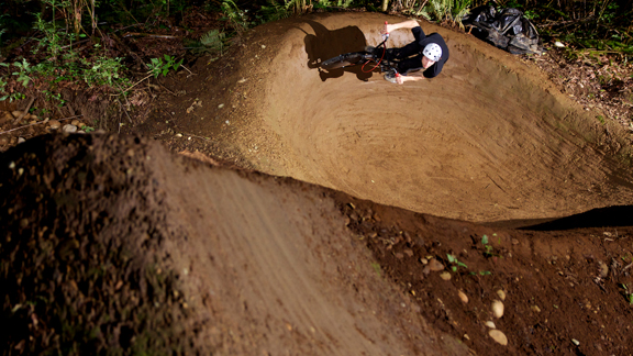 ERDP construction's Luke Fulgham carves a berm.