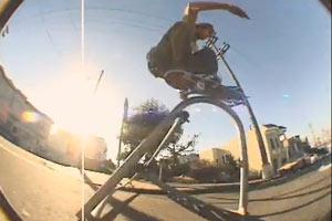 Matt Field blasts a pole jam on a flipped bike rack in the hills of San Francisco.