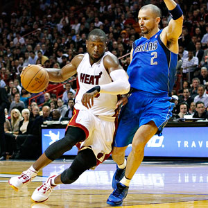 The Heat's Dwyane Wade shows off his handle on Jason Kidd.