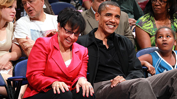 Sheila Johnson shares a courtside laugh with President Barack Obama.