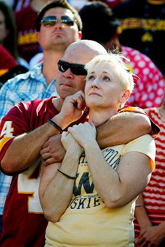 Fans hug
