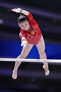 China's He Kexin was the 2008 Olympic champion on bars, but failed to make finals in Tokyo.