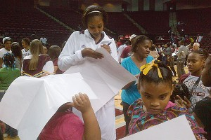 Texas A&M players, such as sophomore Karla Gilbert, often stay after games to mingle with fans and sign autographs.