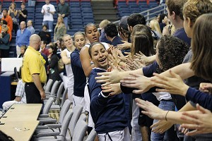 UConn players take postgame laps after the game, sharing another victory with their fans.