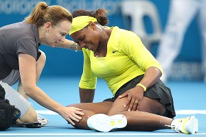 Serena Williams played through an ankle injury and won at the Brisbane International, then withdrew from the tournament.