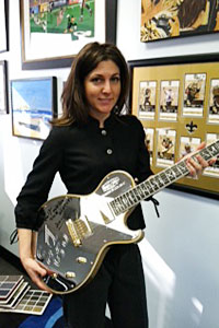Rita Benson LeBlanc, with the guitar one Saints fan made to commemorate the season.
