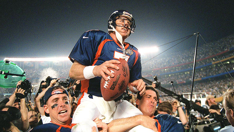 John Elway gets carried off of the field
