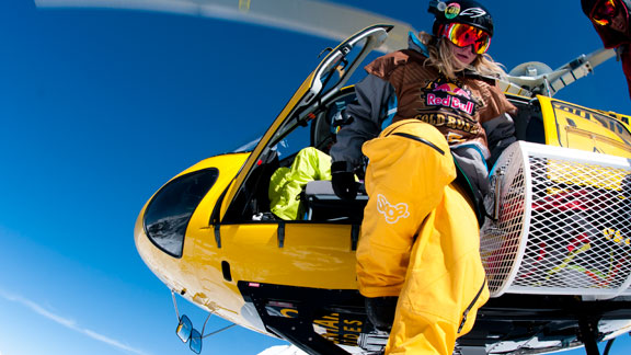 Colin Collins climbing out of the helicopter that delivered athletes to the top of the venue.