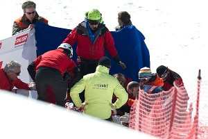 Staff members and medical assistants attend to Canada's Nik Zoricic after a fatal crash Saturday during a World Cup skicross race in Switzerland.