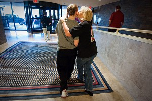 Lindy La Rocque gets a kiss from her mother, Beverly, before the West Virginia game. Even if it's a quick hello, or a kiss and a 'See you later,' it feels good that they are here to support me, Lindy said.