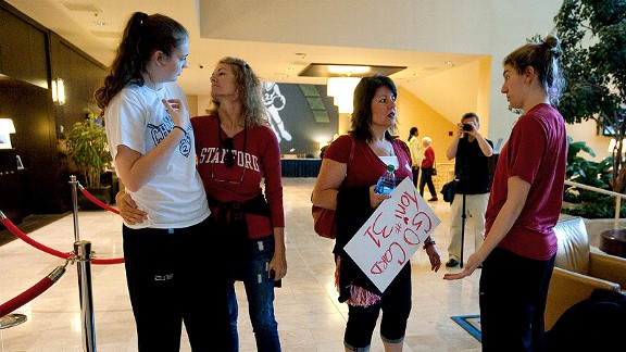Bonnie Samuelson, left, and Toni Kokenis chat briefly with their mothers in the hotel lobby before Stanford's win over West Virginia in the second round of the NCAA tournament in Norfolk, Va.
