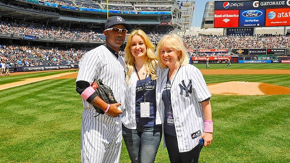 Erika Rech, center, and her mother, Carol, pose for a photo with Yankees outfielder Dewayne Wise before Sunday's game.