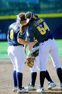 Danielle Henderson (8) and sister Jolene celebrate with a handshake and head-knock during Cal's super regional win over Washington.