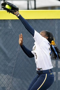 California's Jamia Reid hauls in a deep foul ball near the fence.