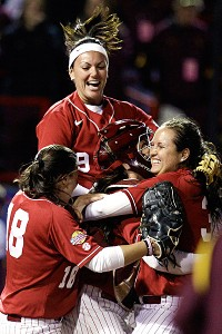 Alabama's Cassie Reilly-Boccia (18), Courtney Conley (9), catcher Kendall Dawson, and pitcher Jackie Traina, right,  celebrate Friday's win against Arizona State.