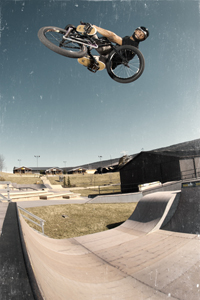 Tweaked lookback at height on the Woodward Camp outdoot mini ramp.