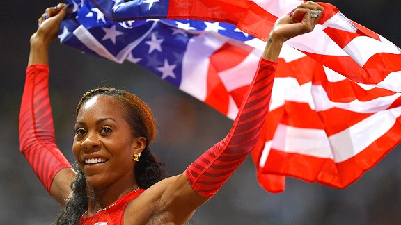 Sanya Richards-Ross proudly displays the American flag after winning the women's 400 meters.