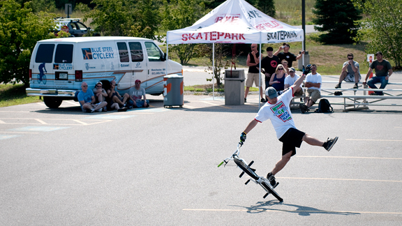 Scott Moroney, can-can lawnmower at the King of Flatland 25th anniversary.