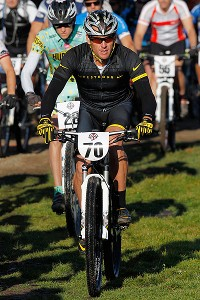 One day after he was banned from professional cycling by the USADA, Lance Armstrong competed in the Power of Four mountain bike race Saturday in Aspen, Colo.