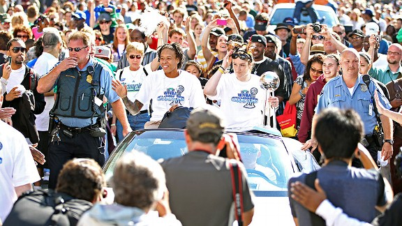 Lindsay Whalen, right, and Seimone Augustus shared a ride at the Lynx championship parade last fall.