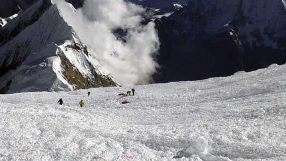 Rescuers search for survivors in the avalanche debris that killed 11 in September on Nepal's Mount Manaslu.