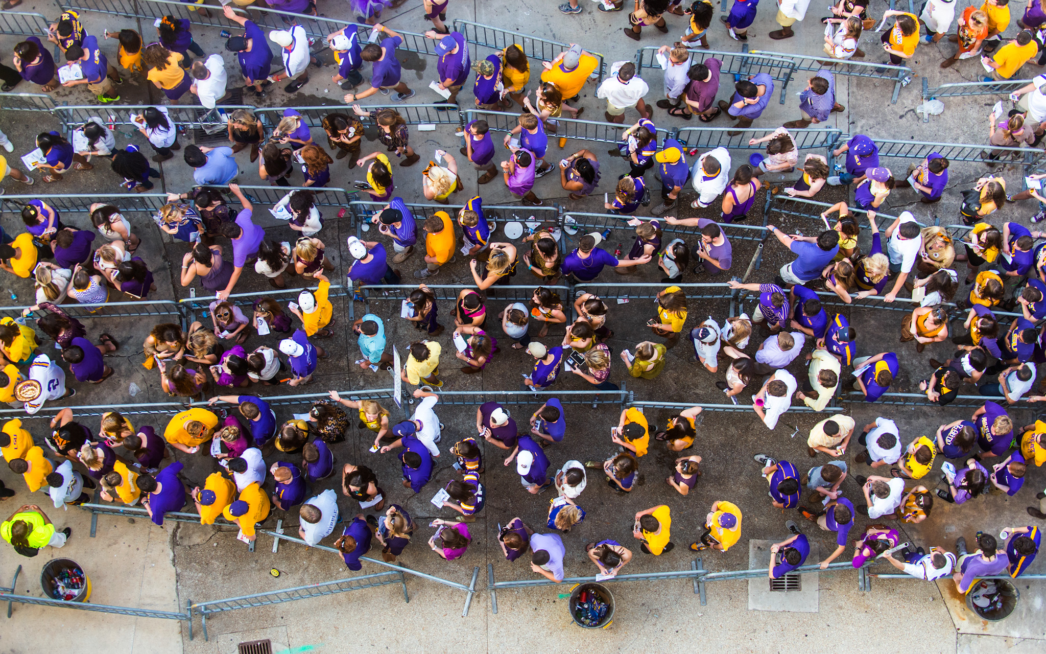 Students line up to enter Tiger Stadium