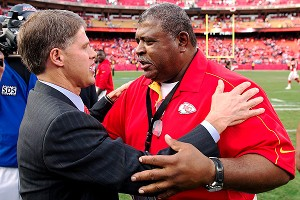 Then-Chiefs coach Romeo Crennel gets a hug from team CEO Clark Hunt after an emotional win Dec. 2, 2012, the day after Belcher's murder-suicide.