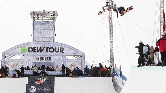 Shaun White throws a trademark monster backside air on his way to winning Dew Tour pipe.