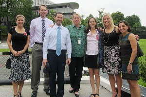 U.S. coaches and diplomats pose outside the U.S. Embassy in Singapore.