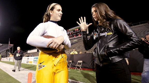 Kent State sophomore place-kicker April Goss, a rare female on a college football team, had plenty to talk about with Patrick.