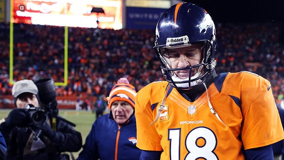 Peyton Manning leaves the field after the Broncos lost the Ravens in last year's divisional round.