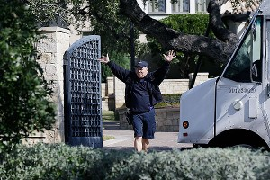 A delivery man waves to media camped outside the home of cyclist Lance Armstrong in Austin, Texas. Armstrong is scheduled to give a no-holds barred interview to Oprah Winfrey on Monday.
