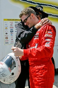 Richard Petty and Dale Earnhardt Jr. share a moment during All-Star weekend in 2007 at Charlotte Motor Speedway.