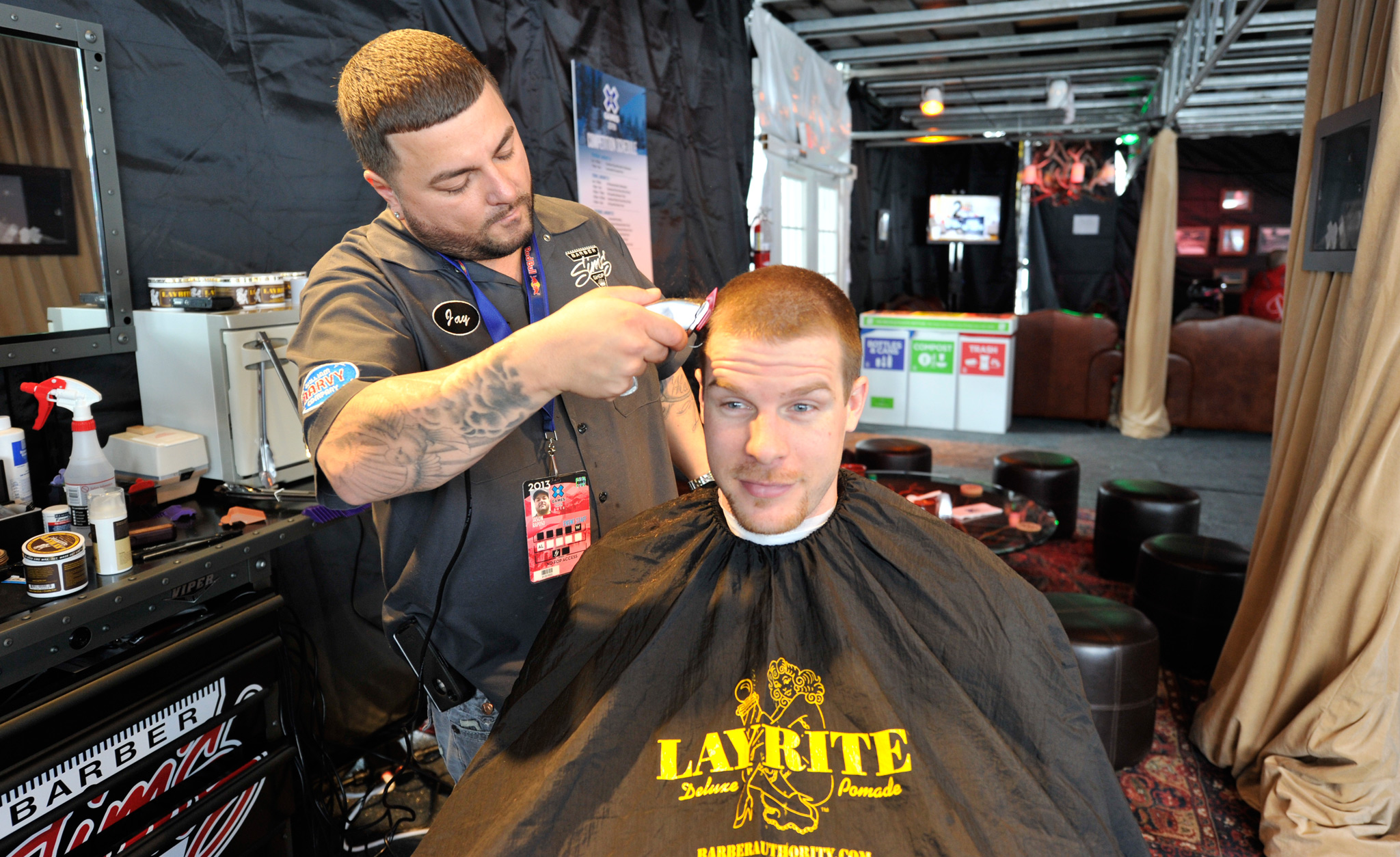 Pro SnoCross rider Tucker Hibbert goes in for a close shave with the barber at Uncle Jack's Parlor on Buttermilk Mountain.