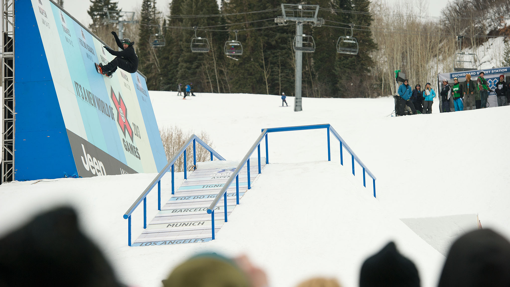 Louif Paradis rides the wall on the Snowboard Street course.