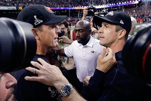 Brothers Jim (left) and John Harbaugh embrace at midfield after Sunday night's game. Said John after leading the Ravens past Jim's Niners: I told him I loved him. He said, 'Congratulations.'