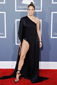 Not as shocking as that ol' Versace number, but Jennifer Lopez does her best Angelina Jolie 'leg' walk on the Grammys red carpet.