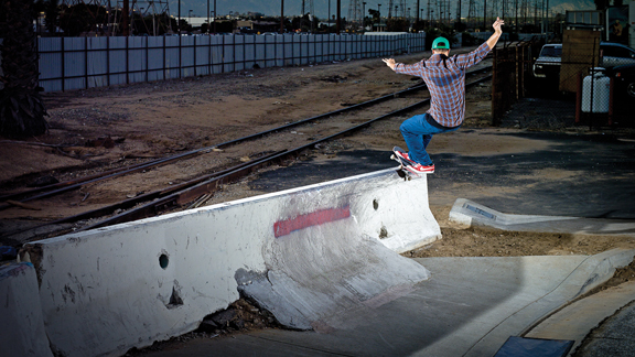 Eric Koston frontside feeble grinds a Jersey barrier with Swoosh grip.