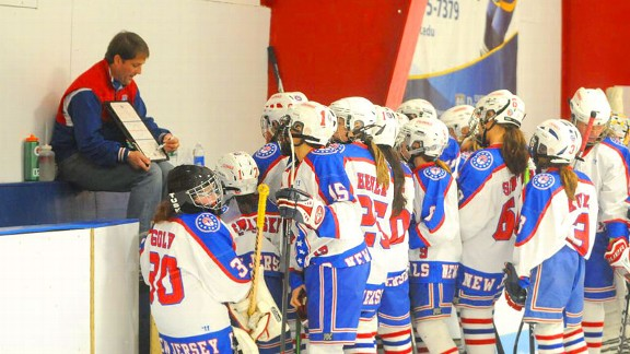 Coach Mike Cornell gathers his team in front of the bench at a recent Colonials game.