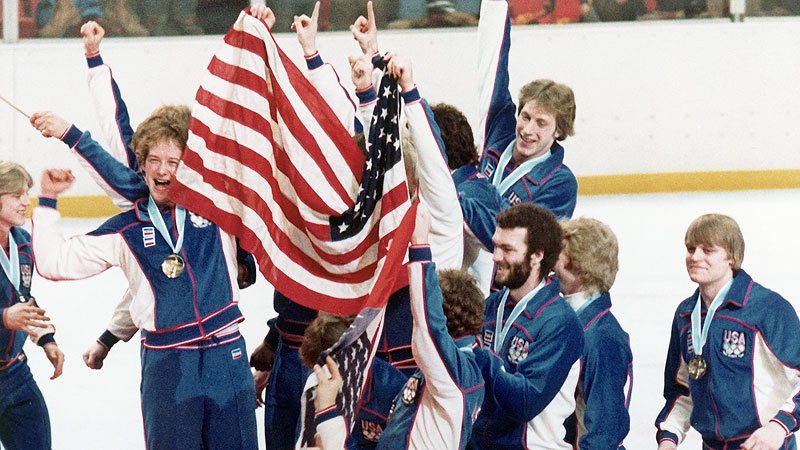 Members of the USA hockey team celebrate their improbable gold-medal win at the 1980 Olympics in Lake Placid.