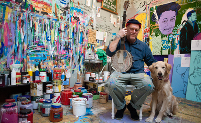 Tim Kerr in his studio space with Clancy.