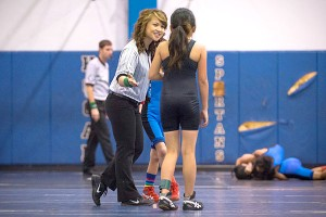 Former Springstowne wrestler Jonna Palma fills a new role as referee during the wrestling championships.