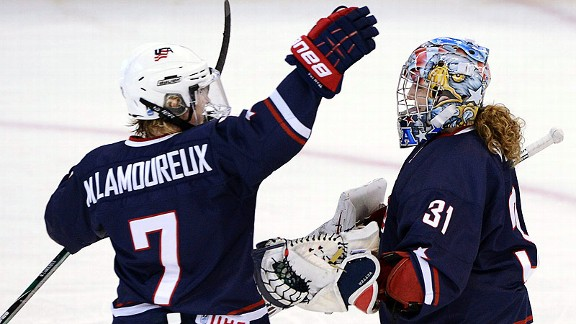 Monique Lamoureux, left, congratulates goaltender Jessie Vetter after the U.S. shut out Finland in the semifinals.